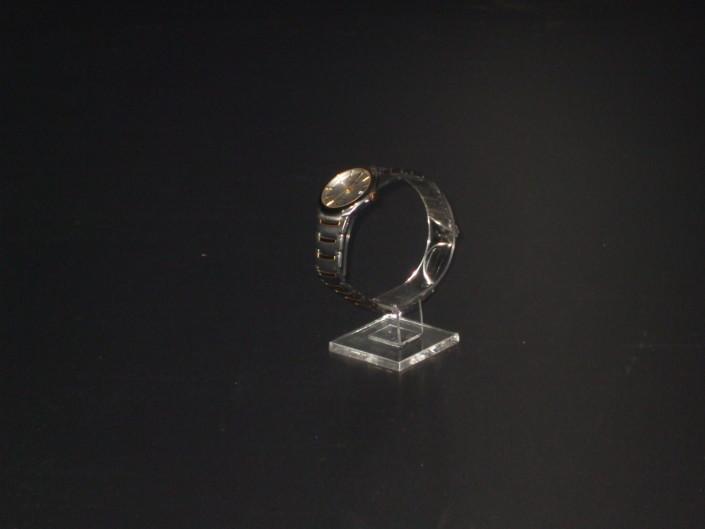 Плексигласова стойка за часовник